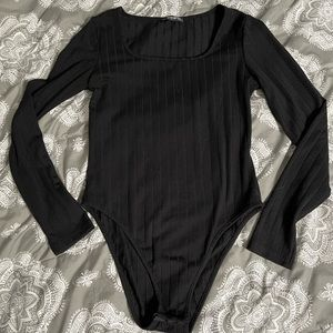 Black ribbed body suit
